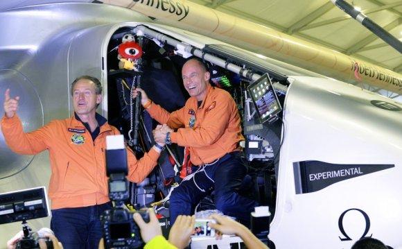Swiss pilots Andre Boschberg