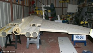 In progress: This picture shows the wooden structure of Mr Johnson's model Vulcan being worked on in his garage in Warrington