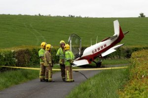 The two men suffered minor injuries after their crash landing.