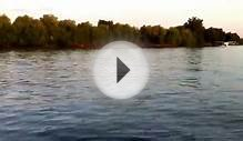 Plane landing on water party boat QC