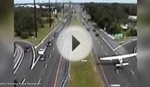 Terrifying moment light aircraft lands between highway lanes